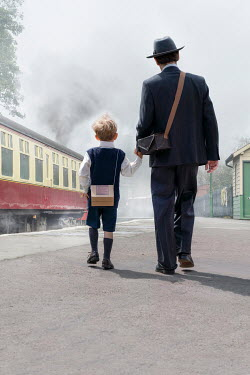 Stephen Mulcahey 1940S MAN WITH SON BY TRAIN Children