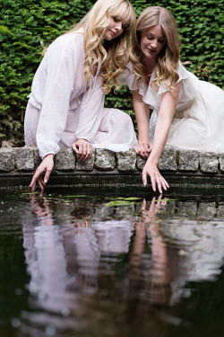 Holly Leedham TWO WOMEN TOUCHING WATER Women