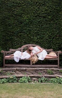 Holly Leedham TWO WOMEN LYING ON BENCH Women