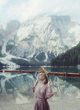 Marta Syrko VINTAGE WOMAN STANDING BY MOUNTAIN LAKE Women