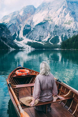 Marta Syrko WOMAN IN BOAT IN MOUNTAIN LAKE Women