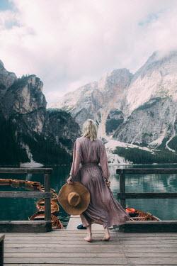 Marta Syrko WOMAN LOOKING OVER ALPINE LAKE Women