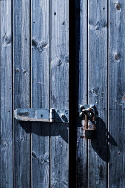 Benjamin Harte RUSTY PADLOCK ON WOODEN DOORS Building Detail