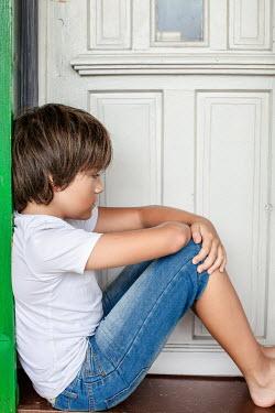 Des Panteva BOY SITTING OUTSIDE FRONT DOOR Children