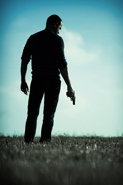 Magdalena Russocka man with gun standing in field Men