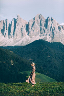 Marta Syrko WOMAN STANDING IN ALPINE MEADOW Women