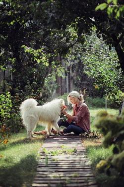 Marta Syrko BLONDE WOMAN AND WHITE DOG Women