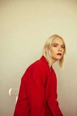 Alina Zhidovinova BLONDE WOMAN IN RED JACKET Women