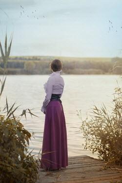 Ildiko Neer Historical woman at lake in summer Women