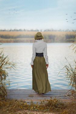 Ildiko Neer Historical woman walking on jetty Women