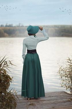 Ildiko Neer Historical woman standing on jetty Women