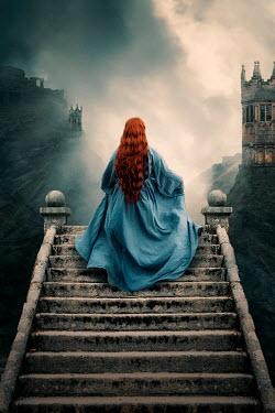 Rekha Garton RED HAIRED WOMAN CLIMBING STONE STAIRCASE Women