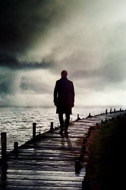Nik Keevil MAN ON JETTY BY WATER AT DUSK Men