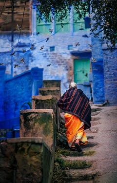 Ashraful Arefin OLD WOMAN CLIMBING STEPS TO BUILDING Old People