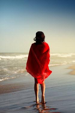 ILINA SIMEONOVA WOMAN IN RED ON SUMMERY BEACH Women