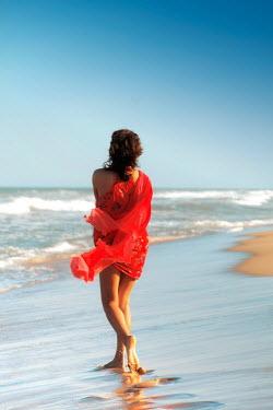 ILINA SIMEONOVA WOMAN IN RED ON BREEZY SUMMER BEACH Women
