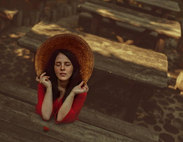 Svitozar Bilorusov WOMAN IN HAT WITH STRAWBERRY OUTDOORS Women