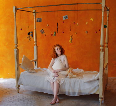 Svitozar Bilorusov WOMAN ON BED WITH HANGING TOYS Women