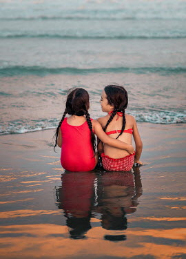 Lilia Alvarado TWO LITTLE GIRLS SITTING IN SEA Children