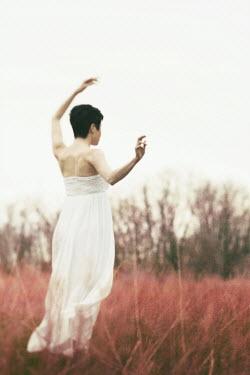 Lisa Bonowicz WOMAN IN WHITE DRESS IN FIELD Women