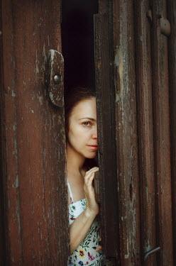 Svitozar Bilorusov WOMEN PEERING THOUGH WOODEN DOOR Women