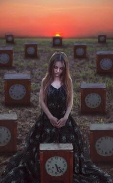 Svitozar Bilorusov YOUNG GIRL IN FIELD OF CLOCKS Children
