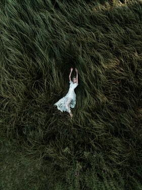Jovana Rikalo WOMAN LYING ON LONG GRASS Women