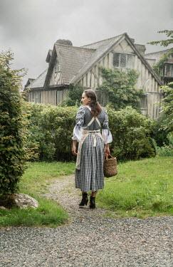 Stephen Mulcahey maid walking towards manor house Women