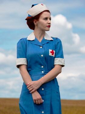 Elisabeth Ansley CLOSE UP OF RETRO NURSE OUTDOORS Women