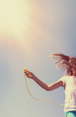 Elisabeth Ansley GIRL SKIPPING WITH ROPE IN SUNLIGHT Children