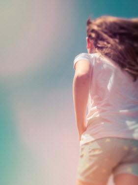 Elisabeth Ansley CLOSE UP OF GIRL RUNNING IN SUNLIGHT Children