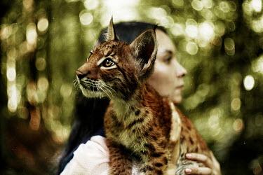 Alexandra Bochkareva WOMAN HOLDING CAT IN COUNTRYSIDE Women