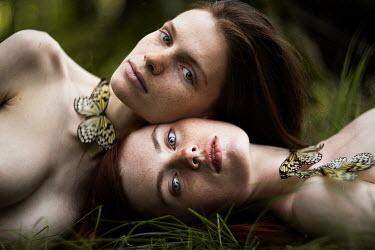 Alexandra Bochkareva TWO GIRLS WITH BUTTERFLIES LYING OUTDOORS Women