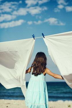 Krasimira Petrova Shishkova girl by washing line near sea Children