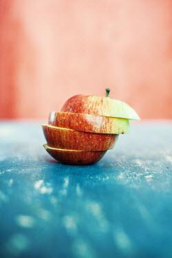 Svetoslava Madarova sliced red apple on table Miscellaneous Objects