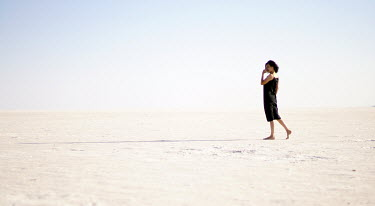 Esmahan Ozkan WOMAN WALKING IN SAND Women