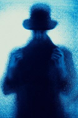 Ildiko Neer Man in hat behind glass Men