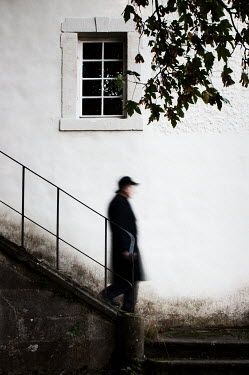 Manuela Deigert OLD MAN WALKING DOWN OLD STAIRWAY Men