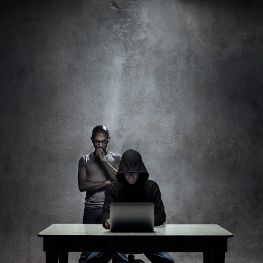 Paolo Martinez HOODED MAN USING LAPTOP Men