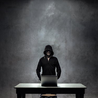 Paolo Martinez HOODED MAN STANDING BY LAPTOP Men