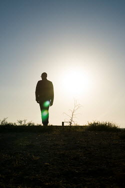 Mohamad Itani SILHOUETTE OF MAN STANDING OUTSIDE Men