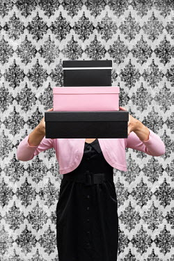 Elisabeth Ansley WOMAN HOLDING PINK AND BLACK BOXES Women
