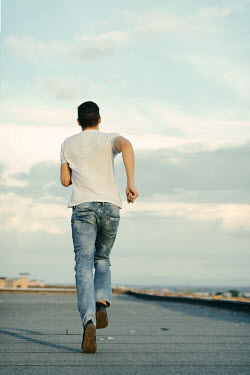 Krasimira Petrova Shishkova man in jeans running Men