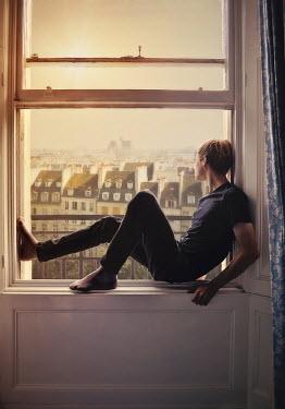 Lyn Randle YOUNG MAN SITTING ON CITY WINDOW LEDGE Men