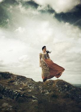 Mark Owen HISTORICAL WOMAN STANDING ON ROCKY MOUND Women