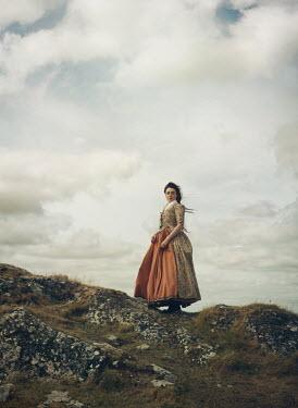 Mark Owen HISTORICAL WOMAN STANDING ON ROCKY HILL Women
