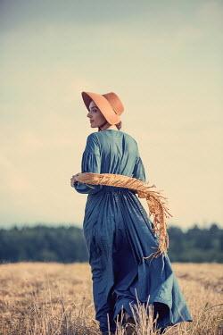 Magdalena Russocka historical woman walking in field Women