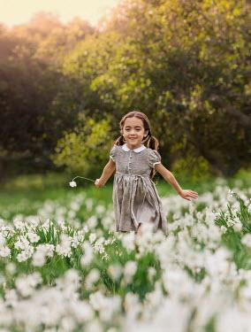 Lilia Alvarado HAPPY LITTLE GIRL IN DAFFODIL FIELD Children