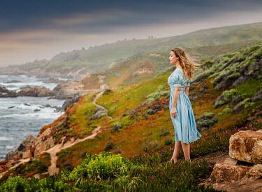 Lilia Alvarado BLONDE GIRL ON CLIFF WATCHING SEA Women