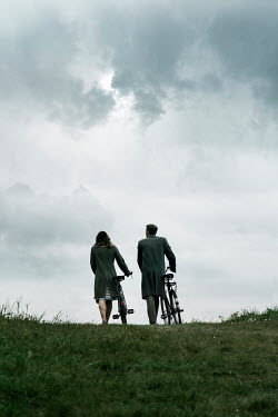 CollaborationJS WARTIME COUPLE WITH BIKES IN COUNTRYSIDE Couples